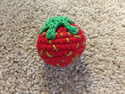 Here is a strawberry that i crocheted,i love making little things like this. So much fun.